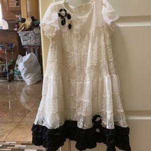 Other - White dress with a black flower and ruffles